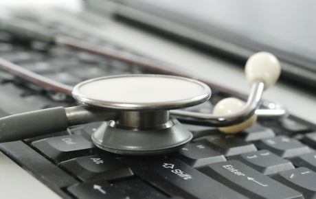 Keyboard and Stethoscope on a Desk
